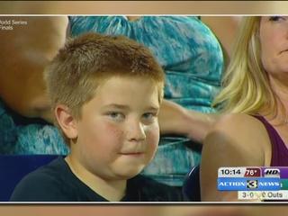 Boy stares down ESPN camera, becomes web hero