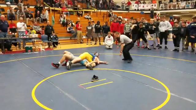 Down syndrome wrestler wins his first match