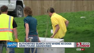 Police search site where 40 dogs were abandoned