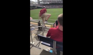 Fan jumps onto field, tackled by grounds crew