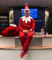 Omaha man flies cross country dressed as an elf
