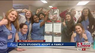 Students raise enough pennies to adopt family