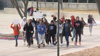 Westside High School students walk out of class