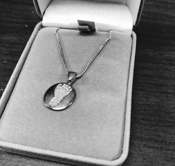 Thumbprint necklaces honor loss of a loved one