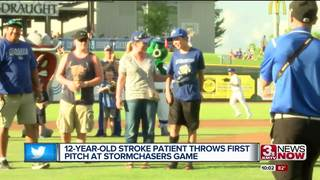 12-year-old stroke victim throws first pitch