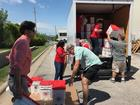 Volunteers take donations to tornado victims