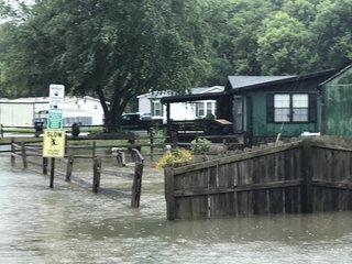 Storms bring wind, record rains, flooding